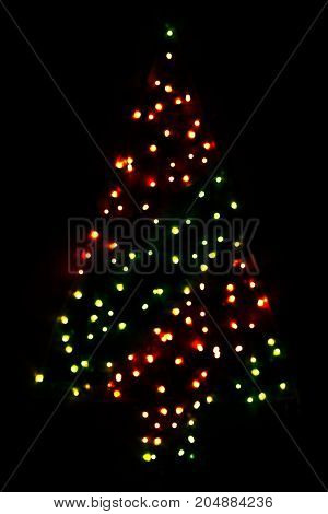 Red And Green Bright Glowing Magic Christmas Tree. Silent And Peaceful Atomosphere. Christmas Card For Happy Holidays Or Seasons Greetings