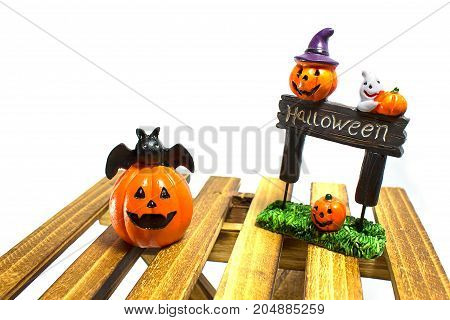 Halloween pumpkin smile and Halloween plate on white background.