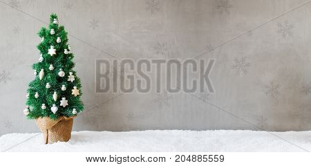 Banner With Green Fir Tree With Silver And Gold Christmas Ball Ornament. Gray Cement Background And Snow. Christmas Greeting Card With Copy Space For Advertisement.