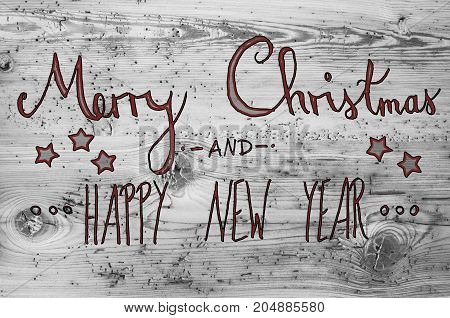 Red English Calligraphy Merry Christmas And Happy New Year. Gray Vintage Wooden Background