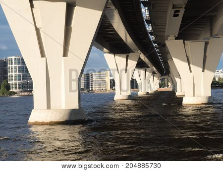 View of a series of bridge supports from the water