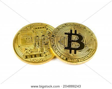 Golden bitcoin coins isolated on a white background