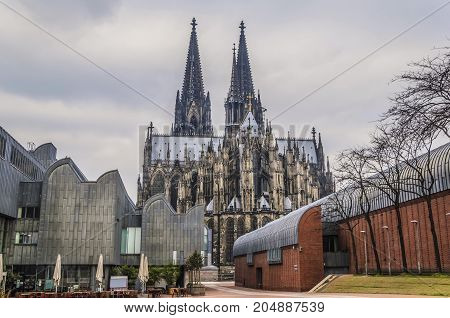 Shock of styles the Gothic of the German cathedral of Cologne dating to one thousand two hundred and forty-eight surrounded by modernist constructions