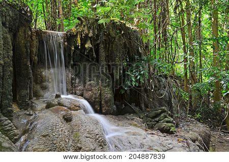 Waterfall in the rainforest (dong pruksa),erawan waterfall national park,kanchanaburi,thailand.