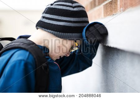 An Elementary school pupil outside with rucksack
