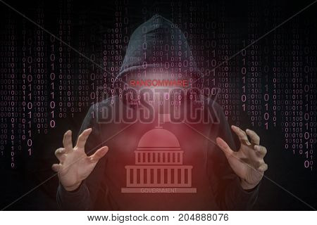 Hacker using ransomware for hijack computer system of government. ransomware cyber attack and internet security concepts.
