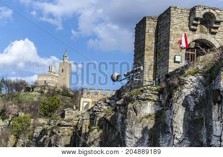 In the background is the cathedral of the Bulgarian city Veliko Tarnovo and to the right the entrance to the old fortress on the bank of Tsarevets here was the capital of the second Bulgarian Empire