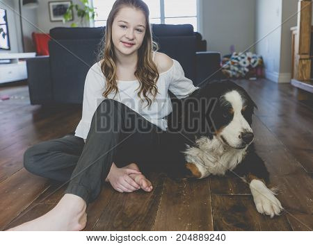 A Teenage girl with dog at home
