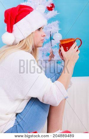 Woman In Santa Hat Holding Holiday Mug, Drinking