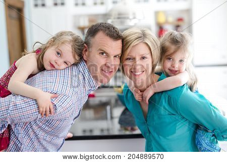 A Joyful family of four in the kitchen