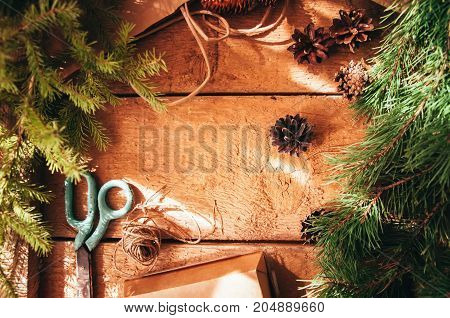 Holiday Gift Wrapping Concept. Festive Christmas Time. Fir Branches And Cones, Packing Twines, Box,