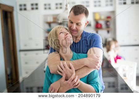 A Happy couple in kitchen having fun together