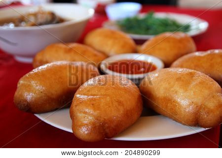 Chinese steamed bun or mantou in deep fried till it become golden color