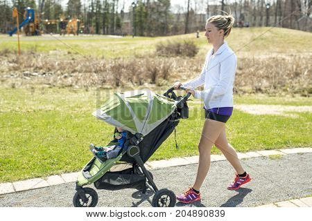 A Mother doing Training, jogging with baby