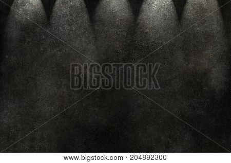 Old grunge black wall, spot lighting. Black wall background or texture