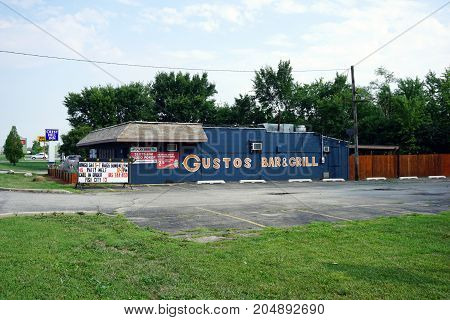 CREST HILL, ILLINOIS / UNITED STATES - JULY 20, 2017: One may drink beer, eat food, and gamble, at Gustos Bar and Grill, on Plainfield Road.