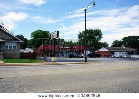 JOLIET, ILLINOIS / UNITED STATES - JULY 21, 2017: One may buy booze at the Consumer Liquors store on Plainfield Road.