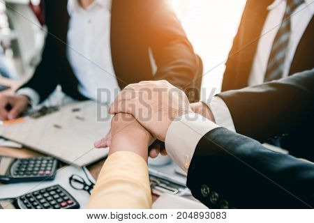 Business people are meeting and shake hands to demonstrate cooperation.