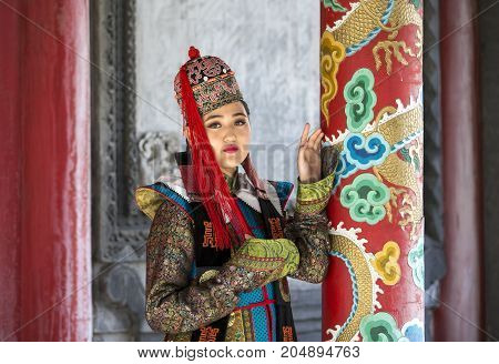 Mongolian Woman In Traditional Outfit In Traditional Outfit