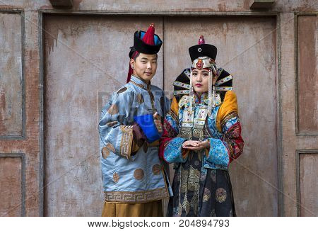 Mongolian Couple In Traditional Outfit In Traditional Outfit