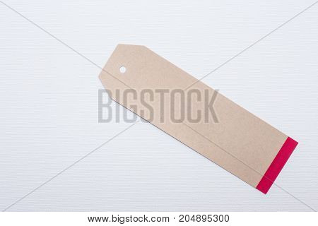 Close up of paper tag on white canvas background