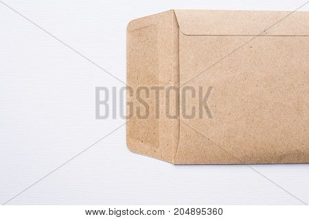 Close up of brown envelope on white canvas background