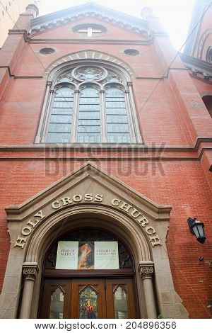 New York USA - 28 September 2016: Front entrance to the Holy Cross Church a Roman Catholic church located at 329 West 42nd Street between Eighth and Ninth Avenues in Manhattan.