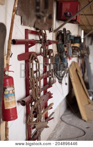 tools for body repair of cars hanging on the wall of the garage