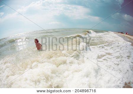 Woman Bathing In The Ocean.