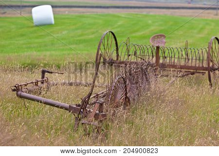 Rusty Plows On A Field Of Iceland
