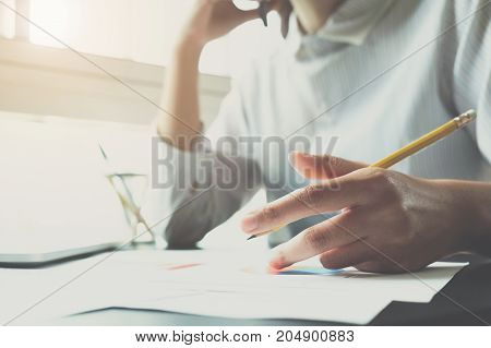 A Woman Talking With Accountant Consult On The Smart Phone And Holding Pencil For Calculating Tax, F