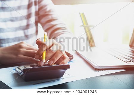Woman Working With Calculator And Business Document And Laptop Computer Notebook, Accountant Concept