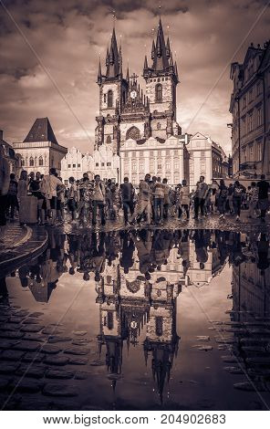 PRAGUE, CZECH REPUBLIC - AUGUST 16, 2017: Church of Our Lady before Tyn reflected in the puddle on rainy summer day