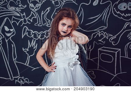 Girl in Bride of Chucky Doll costume costume on dark background with Halloween illustrations.