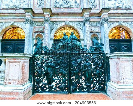 Venice, Italy - May 04, 2017: Theold cast-iron sculptural gates near Bell tower of St. Mark's Basilica in Venice, Italy on May 04, 2017