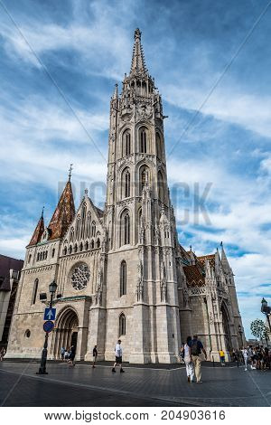 Budapest, Hungary - August 12, 2017:  Matthias Church. It is a Roman Catholic church located in front of the Fisherman's Bastion at the heart of Buda's Castle District. Sunny day of summer