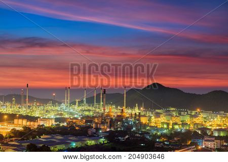 Oil and chemical plant at twilight with beautiful sky background.