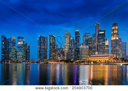 Colorful lights of urban city and business downtown of Singapore. Cityscape Blue hour