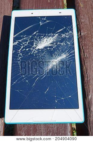 Broken display of a tablet in summer