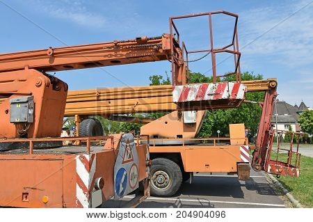 Back side of old crane vehicles in summer