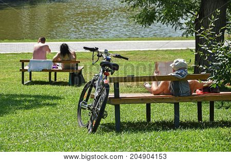 People resting at the lakeside in summer