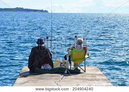 Fishermen at the Adriatic sea in summer