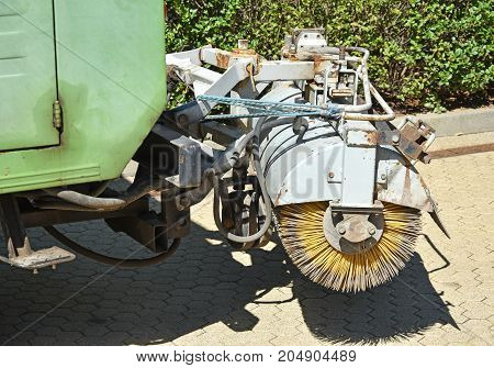 Brush of the street cleaner vehicle in summer