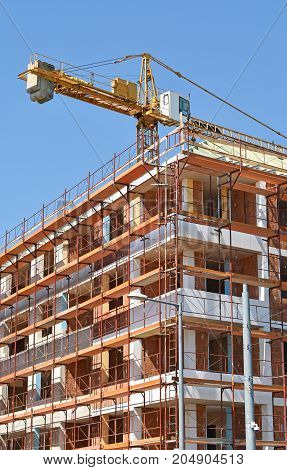 Construction of a new apartment building in summer