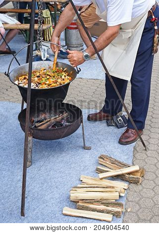 Man is cooking outdoor in summer time food