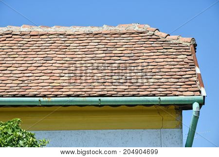 Roof of an old house in summer