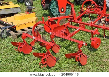 Plow machinery at the agricultural fair in summer