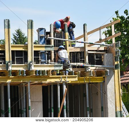 Construction workers at work in summer time