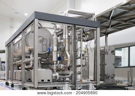 Automatic filling machine. Pouring beer in a brewery.