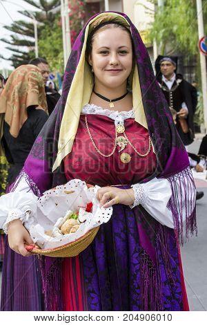 SELARGIUS, ITALY - SEPTEMBER 13, 2015: Ancient Marriage Selargino - Portrait of a beautiful woman wearing a traditional Sardinian costume - Sardinia